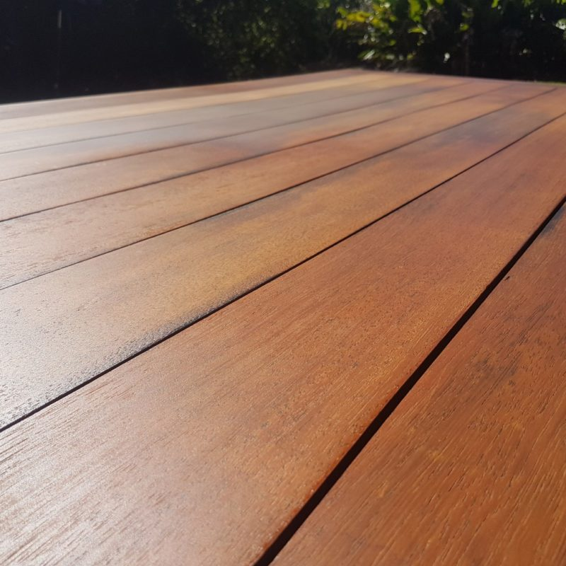 Expanse of timber that has been treated with oil to rejuvinate the surface on this outdoor table